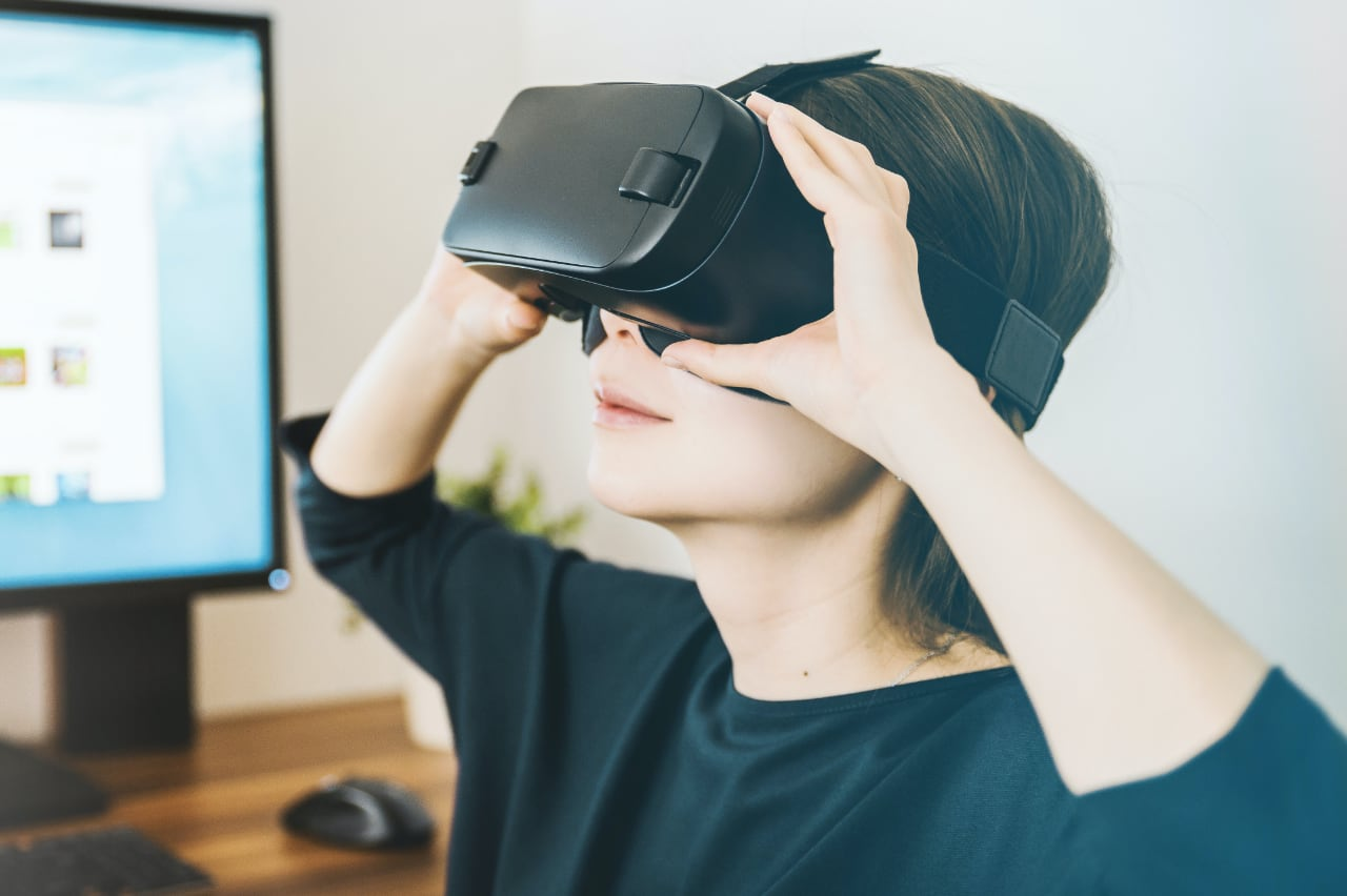 A person using a virtual reality headset.