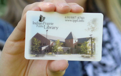 A person holding a Indian Prairie Library card